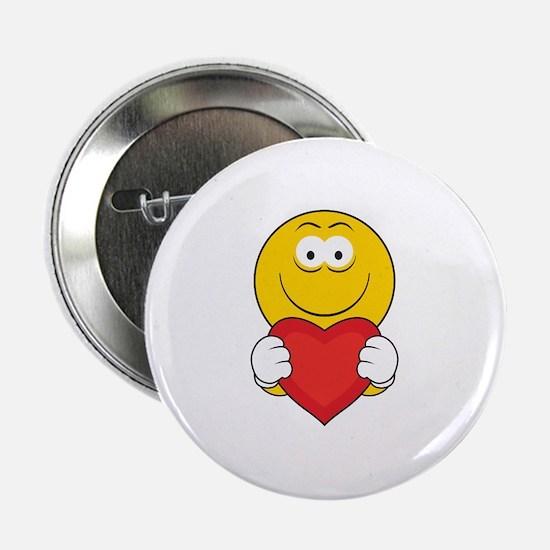 "Smiley Face Holding Heart 2.25"" Button"
