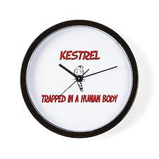 Kestrel trapped in a human body Wall Clock