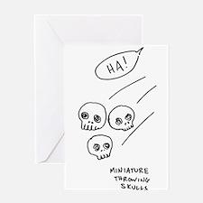"""Miniature Throwing Skulls"" Greeting Card"