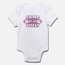 Owned By An Ocicat Infant Bodysuit