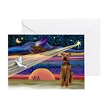XmasSunrise/2 Airedales Greeting Card