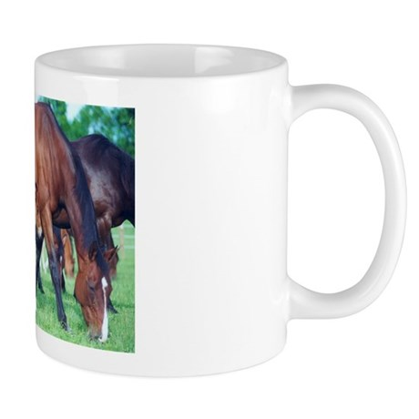 Mares and foals grazing Mug