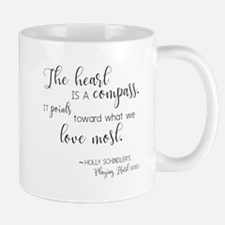 The Heart Is a Compass Mugs