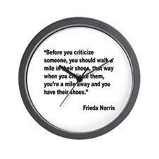 Norris Criticism Quote Wall Clock