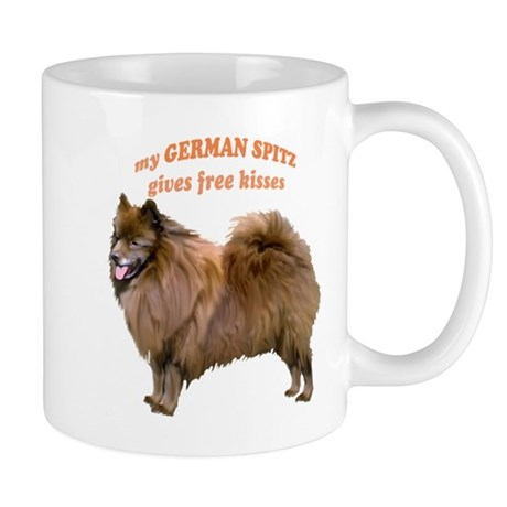 German Spitz kisses Mug