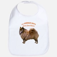 German Spitz kisses Bib