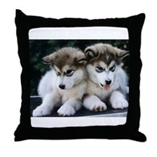 The Huskies Throw Pillow