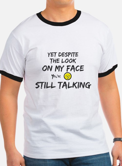 Yet despite the look on my face. You're st T-Shirt