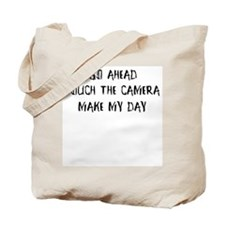 Go ahead. Touch the camera Tote Bag