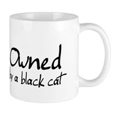owned by a black cat Small Mug