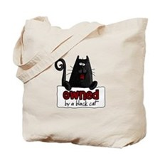 owned by a black cat Tote Bag