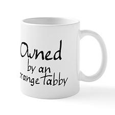 owned by an orange tabby Mug