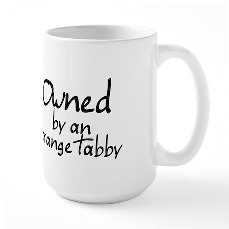 owned by an orange tabby Large Mug