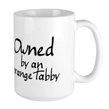 owned by an orange tabby Mug