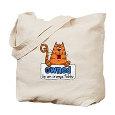 owned by an orange tabby Tote Bag