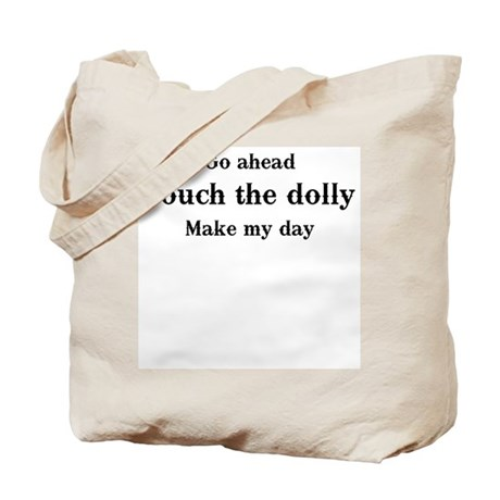 Go ahead. Touch the dolly. Tote Bag