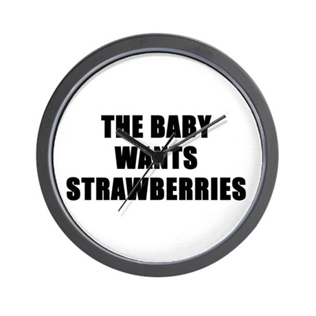 The baby wants strawberries Wall Clock