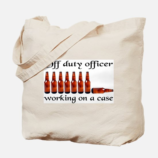 Off duty officer working on a Tote Bag