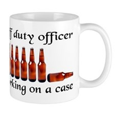 Off duty officer working on a Mug