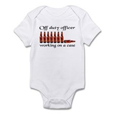 Off duty officer working on a Infant Bodysuit