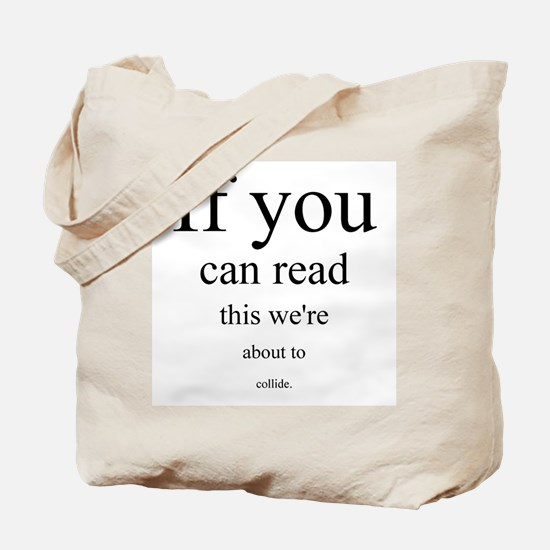 ...about to collide. Tote Bag