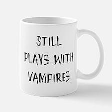 Still plays with vampires Mug