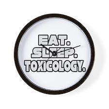 """Eat. Sleep. Toxicology."" Wall Clock"