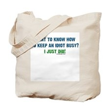 Keeping an idiot busy Tote Bag
