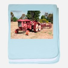 Old rusty tractor in the country baby blanket