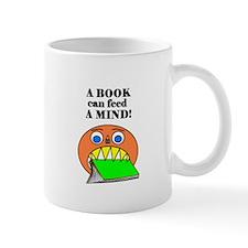 A BOOK CAN FEED A MIND Mug
