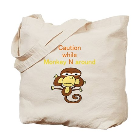 """Caution while Monkey N Aroun Tote Bag"