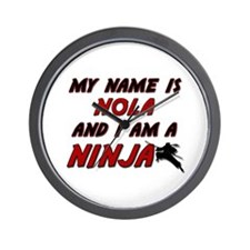 my name is nola and i am a ninja Wall Clock