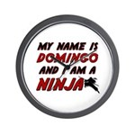 my name is domingo and i am a ninja Wall Clock