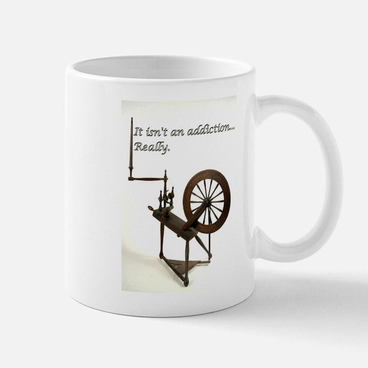 2-spinning wheel addiction Mugs