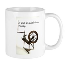 2-spinning wheel addiction Mugs