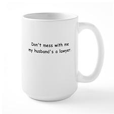 My husband's a lawyer Mug
