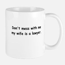 My wife's a lawyer Mug