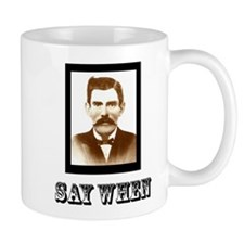 4-saywhenshirt Mugs