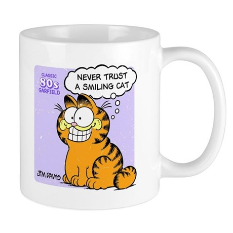 Never Trust a Smiling Cat Mug