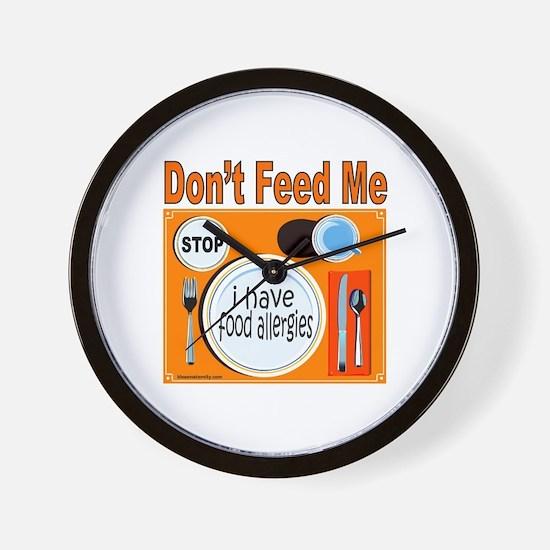 DON'T FEED ME Wall Clock