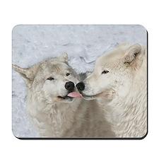 Kissing Arctic wolves mousepad
