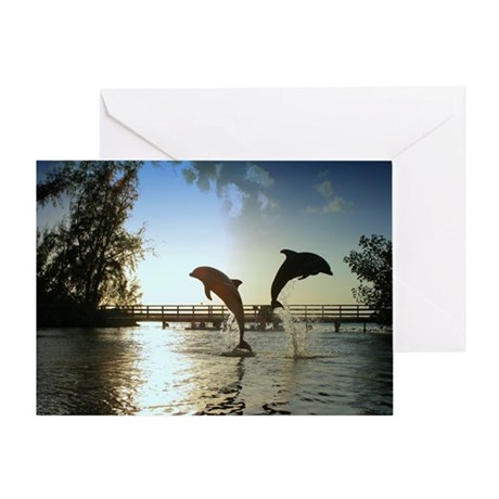 Dolphins Jumping at Sunset Greeting Card