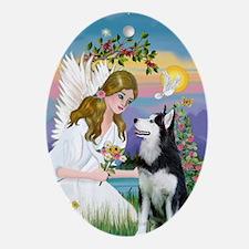 Angel and Siberian Husky Oval Ornament