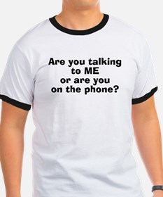 Are You Talking To Me Or On The Phone? T