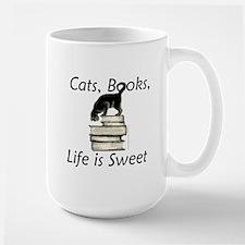 Cat on Books Ceramic Mugs