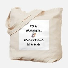 to a hammer... Tote Bag