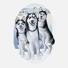 Three Huskies Oval Ornament