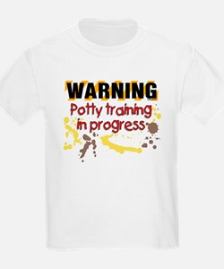 Potty training in progress Kids T-Shirt
