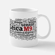 m9_pressrelease3 Mugs