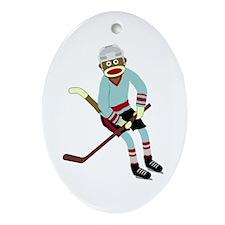 Sock Monkey Ice Hockey Player Oval Ornament